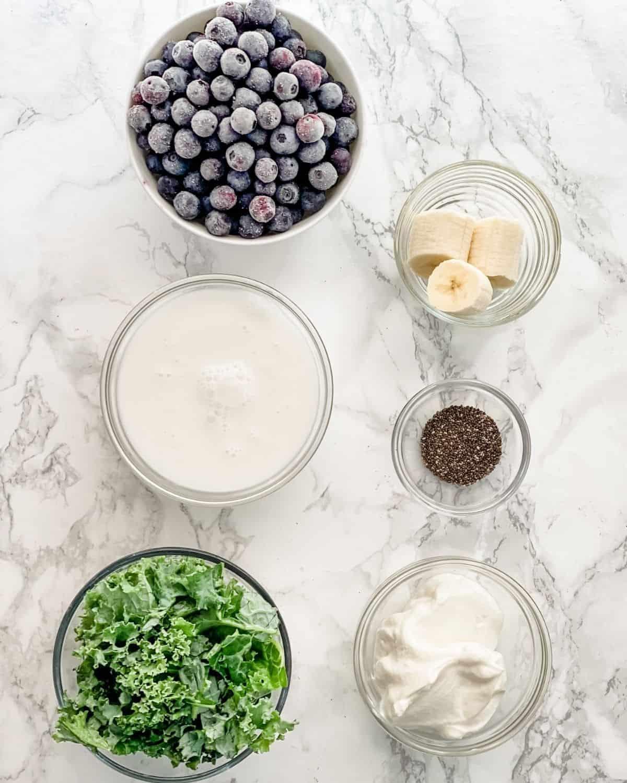 ingredients to make blueberry kale smoothies