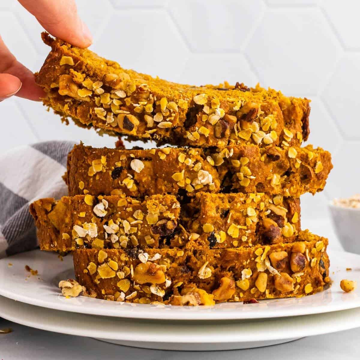 pumpkin apple bread recipe to make this fall. Slices layered on top of one another.