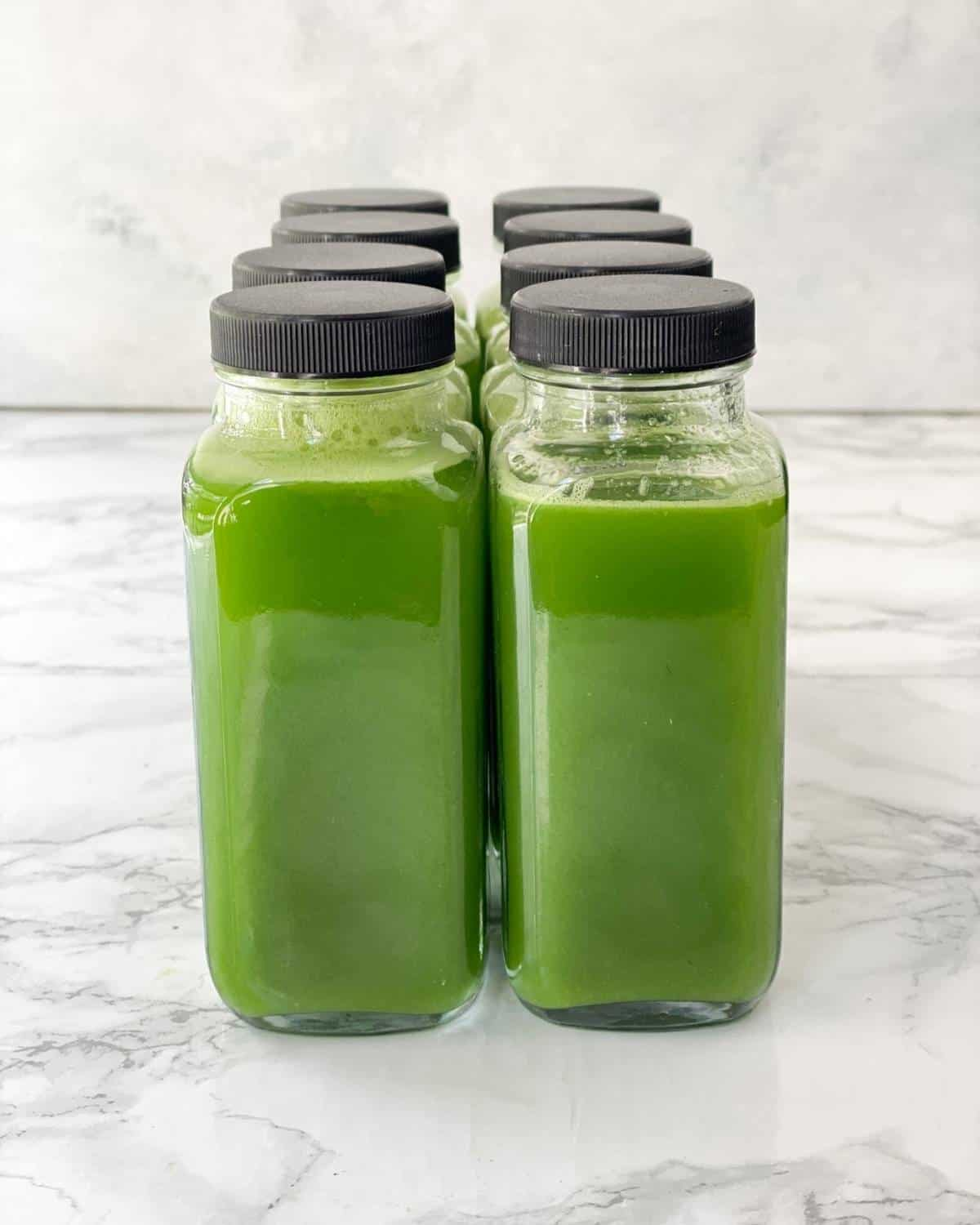 vitamix green juice in glass containers.